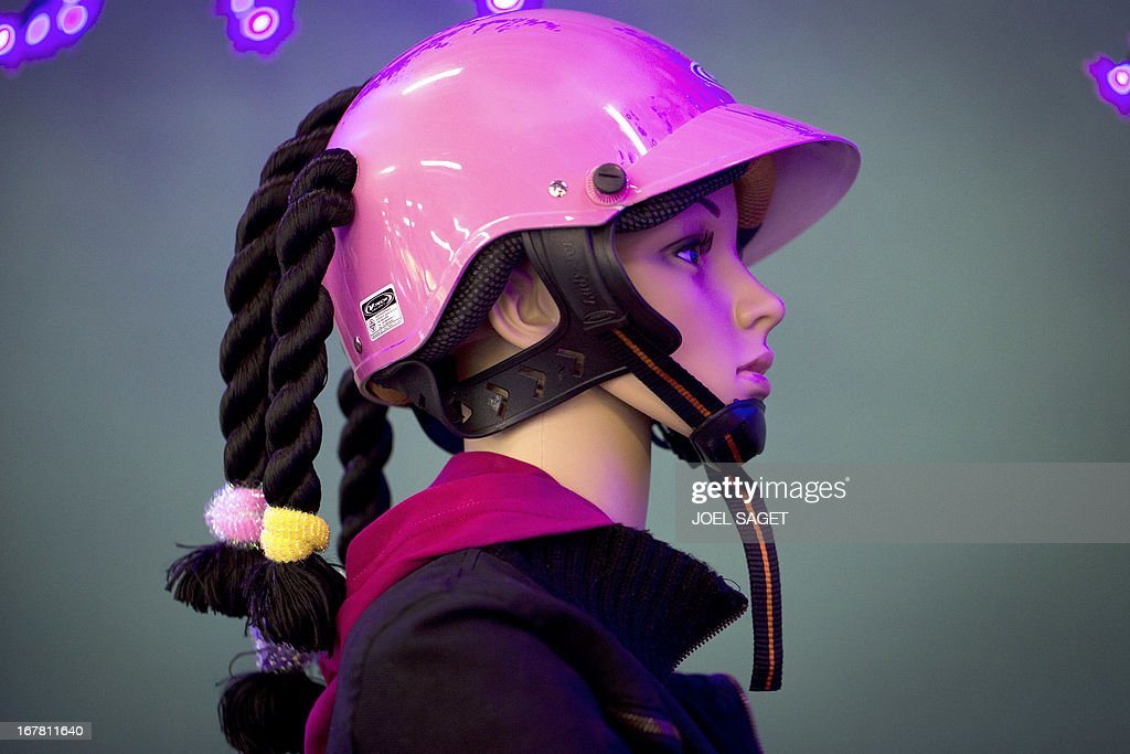 A photo shows a 'chindogu' helmet presented on April 30, 2013 during the 2013 Concours Lepine as part of Paris' Fair at the Porte de Versailles exhibition in Paris. The Concours Lepine is a French inventors' contest created in 1901. The word 'Chindogu' translates as 'weird tools' and refers to the founder of the International Chindogu Society, Kenji Kawakami, who has invented hundreds of bizzare and absurd items.