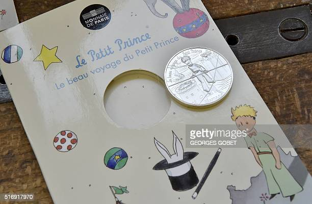 A photo shows a coin displaying the Little Prince character on March 21 2016 at the Monnaie de Paris in Pessac western France The Monnaie de Paris...