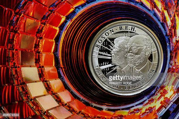 Photo shows a commemorative five euro coin featuring a portrait of Belgian Nobel prize winner Francois Englert at the Royal Mint in Brussels on...