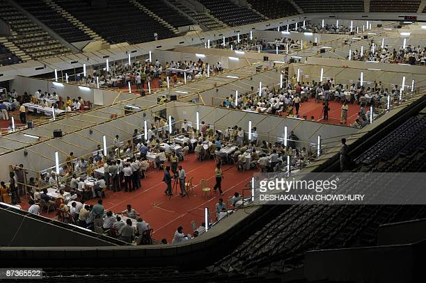 Photo shows a counting center where hundreds of polling officers of the Election Commission of India busy in counting votes from Electronic Voting...