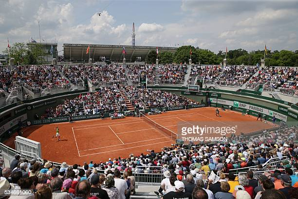 A photo shows a general view of Court 1 during the men's third round match between Spain's Fernando Verdasco and Japan's Kei Nishikori at the Roland...