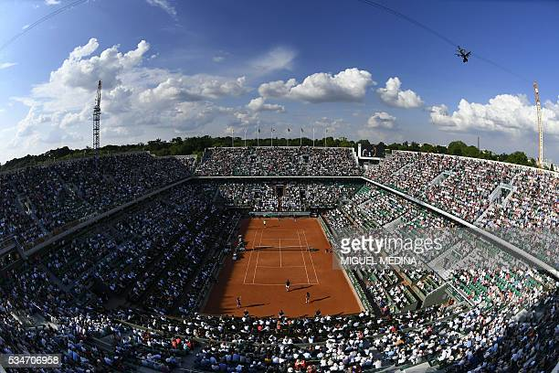 A photo shows a general view of the Philippe Chatrier court during the men's third round match between Switzerland's Stanislas Wawrinka and France's...