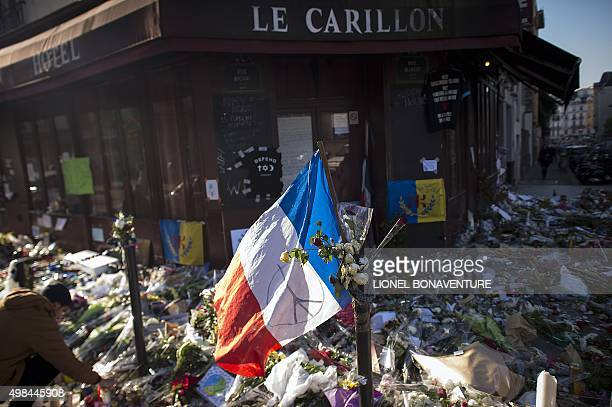 A photo shows a makeshift memorial for a tribute to the victims of a series of deadly attacks in Paris in front of the Carillon cafe in Paris on...