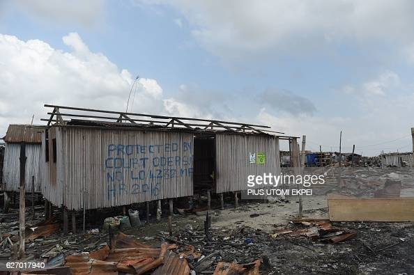 A photo shows a makeshift structure inscribed with a court order obtained to stop the authorities from demolishing shanty town Otodo Gbame waterfront...