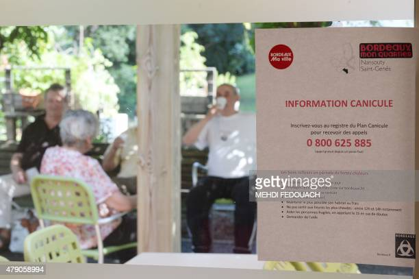 A photo shows a notice on prevention of heat wave at a municipal residence for elderly persons in Bordeaux on June 30 2015 as thermometers were set...