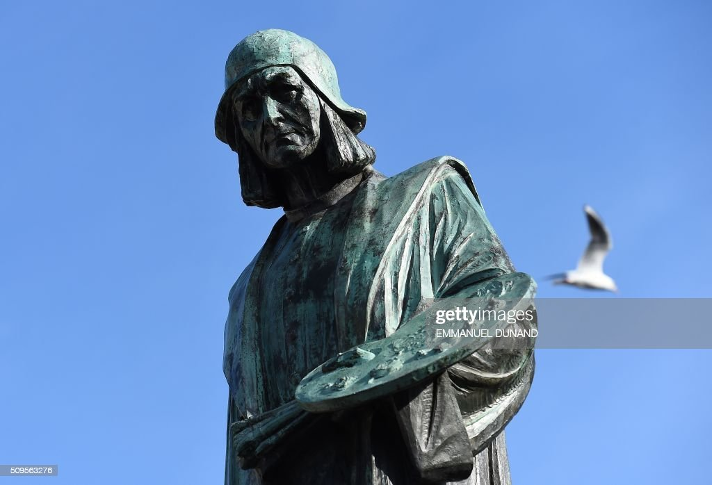 A photo shows a statue of Dutch painter Hieronymus Bosch in front of his workshop in Den Bosch on February 11, 2016. To mark the 500th anniversary of Dutch painter Hieronymus Bosch's death, a small museum in his hometown has managed to bring most of the last 25 known surviving paintings by the man dubbed 'the devil's painter' for a major exhibition of his work scheduled from February 13 to May 8, 2016. / AFP / EMMANUEL DUNAND