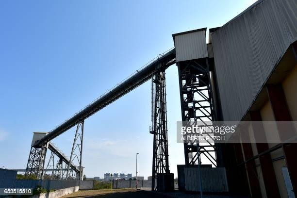 A photo shows a view of a conveyor belt at the French sugar cooperative Cristal UnionSFIR Raffineria di Brindisi sugar refinery in Brindisi on March...