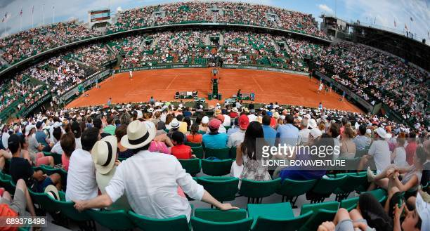 A photo shows an overall view of the Philippe Chatrier court during the tennis match between France's Lucas Pouille and France's Julien Benneteau at...