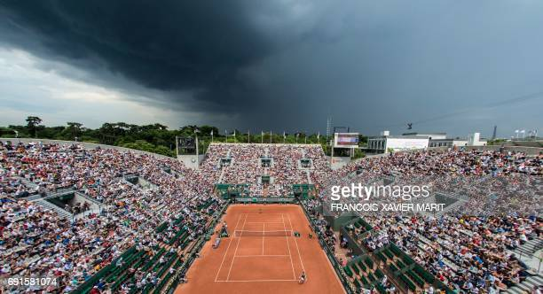 A photo shows an overall view of the Suzanne Lenglen court with the Eiffel Tower in the background during the tennis match between France's Kristina...