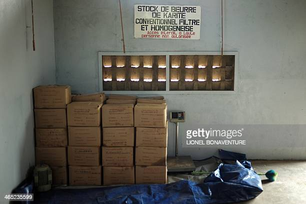 Photo shows boxes of shea butter in a storage hangar to be exported for the French cosmetics company L'Occitane in Leo southcentral Burkina Faso on...