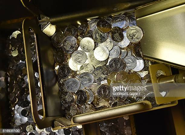 A photo shows coins on March 21 2016 at the Monnaie de Paris in Pessac western France The Monnaie de Paris will create two series of twelve 10euro...