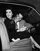 Photo shows Elizabeth Taylor with her fiancee Conrad Nicholas Hilton Jr seated in a car at the end of 1949 or early 1950