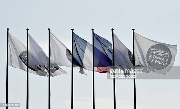 A photo shows flags at the entrance of the Monnaie de Paris in Pessac western France on March 21 2016 The Monnaie de Paris will create two series of...