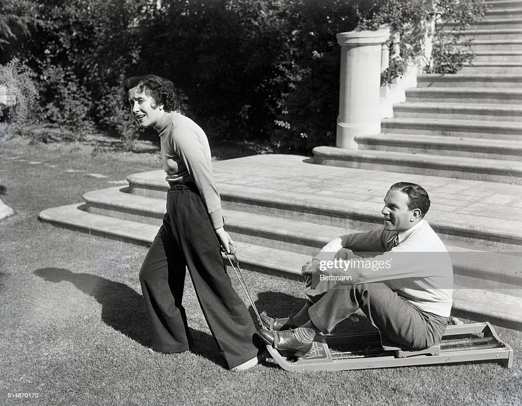 Photo shows Gracie Allen and George Burns finding a bit of time between scenes to take some exercises However it seems as though George is doing all...