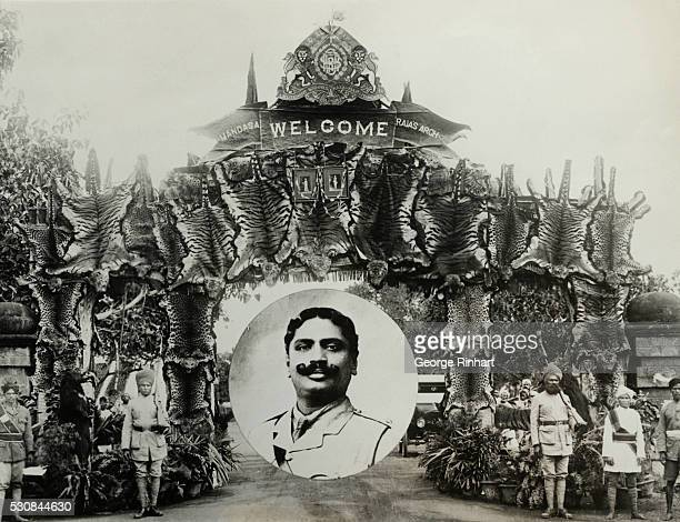 Photo shows in insert the late Rajah of Mandas and the arch of tiger skins of the 20odd man eating beasts which he killed during his hunting career...