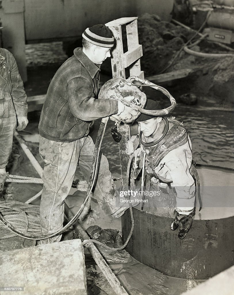 Photo shows James Ingram deep sea diver about to descend into the caisson of the foundation of the new Criminal Courts Building at Center Street