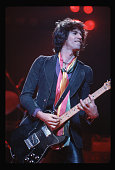 Photo shows Keith Richards guitarist with the rock and roll group The Rolling Stones on stage as he performs in concert Ca 1970s