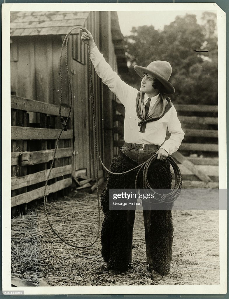 Photo shows Miss Leah MacGinnis Hollister High School girl who will compete for national honors in the bucking horse and roping contests of the...