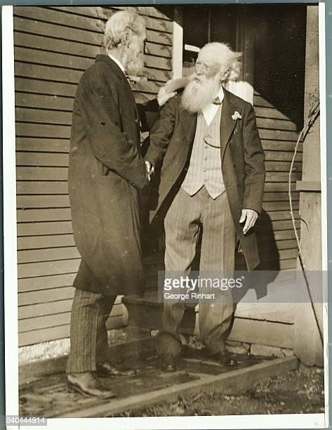 Photo shows naturalist and essayist John Burroughs shaking hands with fellow naturalist John Muir