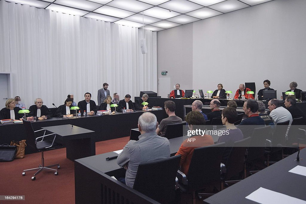 Photo shows ourtroom with the accused Kim De Gelder (C) on the twenty-first day of the assizes trial of Kim De Gelder, at the Gent justice palace, on March 22, 2013. The Belgian court handed down a full-life sentence on Friday to the 24-year-old child killer disguised as Batman villain 'The Joker,' for the murder of four people including two infants..