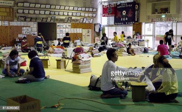 Photo shows people in an evacuation center in the city of Asakura on July 12 following torrential rain in southwestern Japan One week has passed...