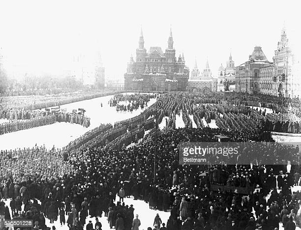 Photo shows Red Square filled with troops and crowds listening to Trotsky hurling defiance to the world at a recent review Background shows complex...