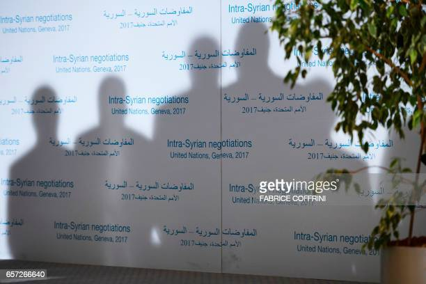A photo shows silhouettes of Syrian chief negotiator and Ambassador of the Permanent Representative Mission of the Syria to UN New York Bashar...