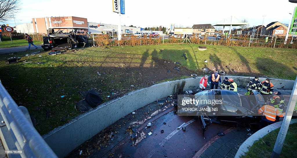Photo shows the aftermath an accident with three cars at the Rode Kruislaan in Bree, on November 25, 2012. One person died in the accident, two got seriously injured. AFP PHOTO YORICK JANSENS