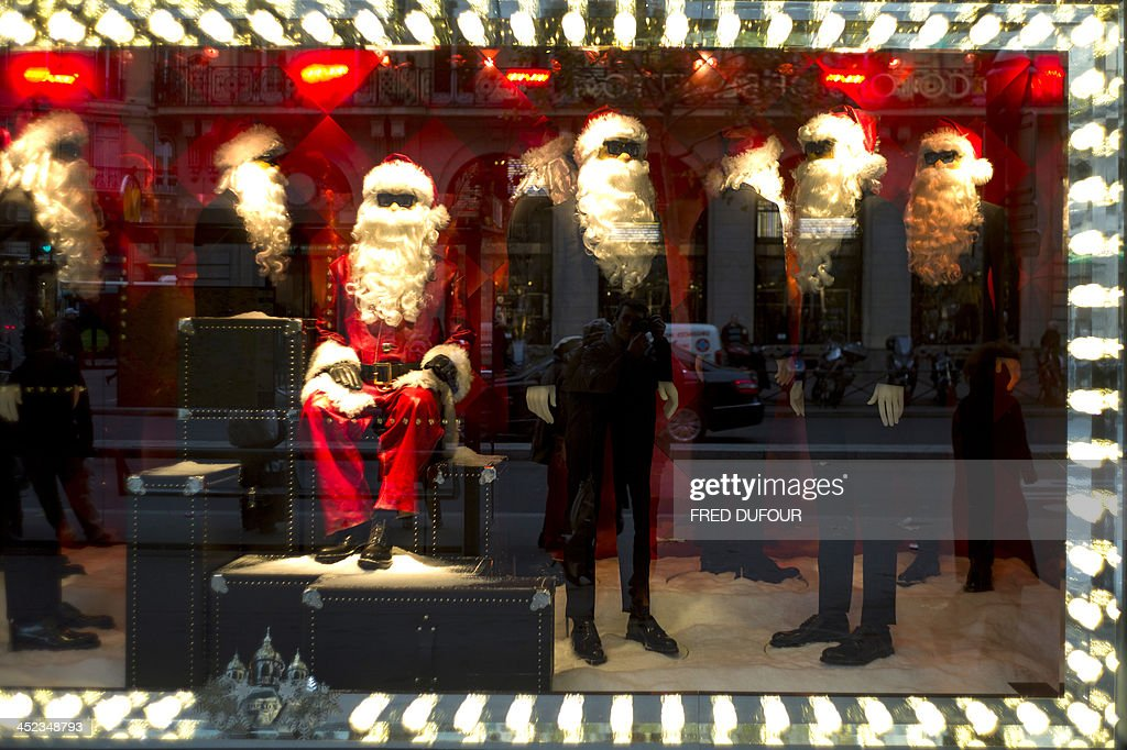 Photo shows the Christmas window display of the Printemps department store in central Paris on November 28, 2013. AFP PHOTO / FRED DUFOUR