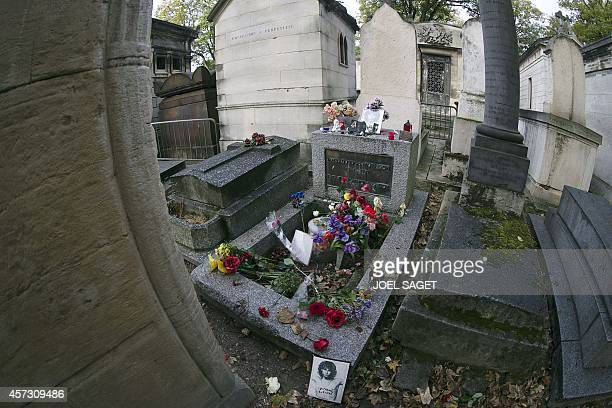 A photo shows the grave of US singer Jim Morrison at the Pere Lachaise cemetery in Paris on October 16 2014 in Paris AFP PHOTO / JOEL SAGET