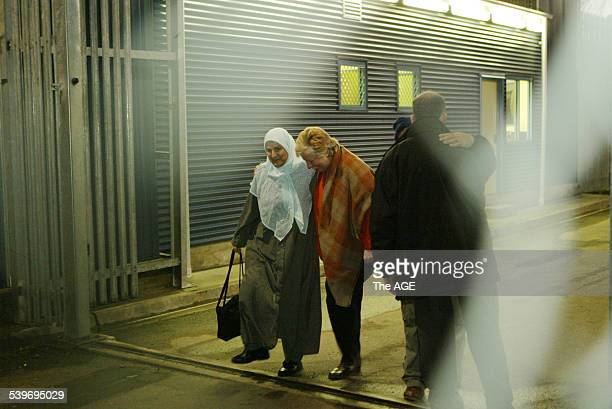 Photo shows the last of the Nauru families Houda left and Khairy alMassaudi embracing the security guard leaving the Maribyrnong Detention Center...