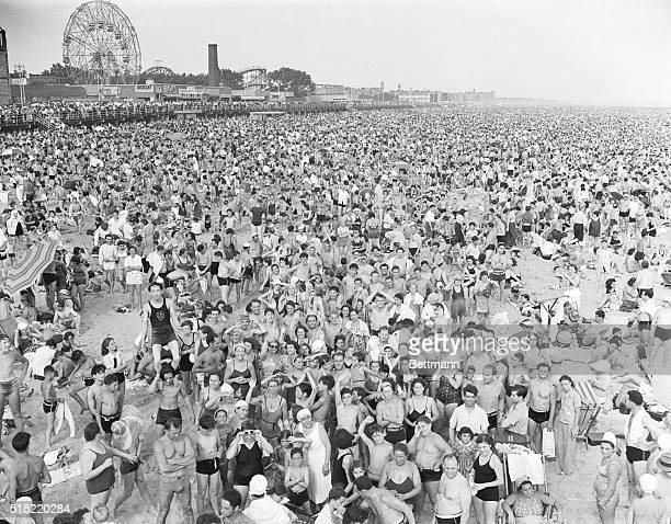 Photo shows the massive crowd at Coney Island in July of 1940 during the massive heat wave In the background can be seen the boardwalk attractions