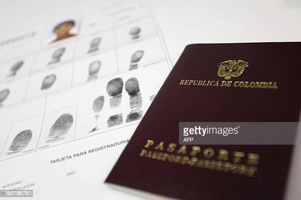 Photo shows the passport and file of a young Columbian in one of Columbia's mobile consulates in Biarritz France on March 16 2013 For the very first...