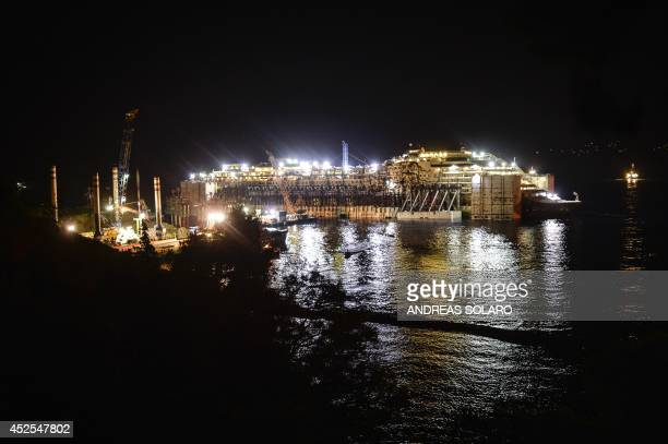 Photo shows the wreck of the Costa Concordia cruise ship in front of the harbour of Isola del Giglio after it was refloated using air tanks attached...
