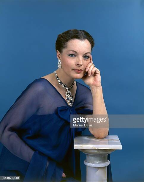 Photo studio Romy Schneider on the occasion of his 40th birthday plan smiling face of the actress in blue dress and Yves Saint Laurent dress with a...