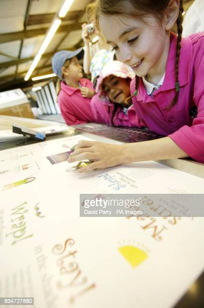Photo Sunsense competition winner Jade Warren aged 8 from Wickham Common Primary School pictured at Oxted Colour Printers Oxted She is taking a close...