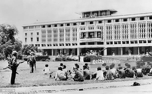 A photo taken 03 May 1975 shows PRG forces seizing control of the presidential palace in Saigon after the fall of the city The war in Vietnam ended...