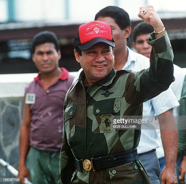 A photo taken 04 October 1989 shows former Panamanian strongman General Manuel Noriega waving as he left his headquarters in Panama City following a...