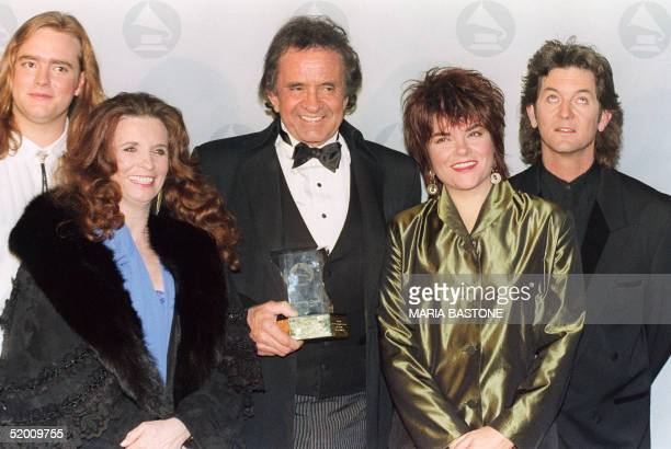 Photo taken 05 December 1990 of US country singer Johnny Cash posing with his son John Carter Cash his wife June Carter Cash his daughter Rosanne and...