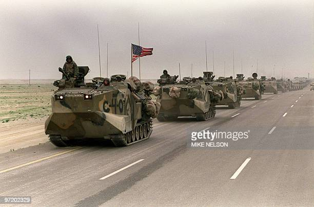 Photo taken 05 March 1991 of a convoy of US Army tanks driving down the road from Kuwait towards Dhahran in the Saudi desert as US troops begin their...