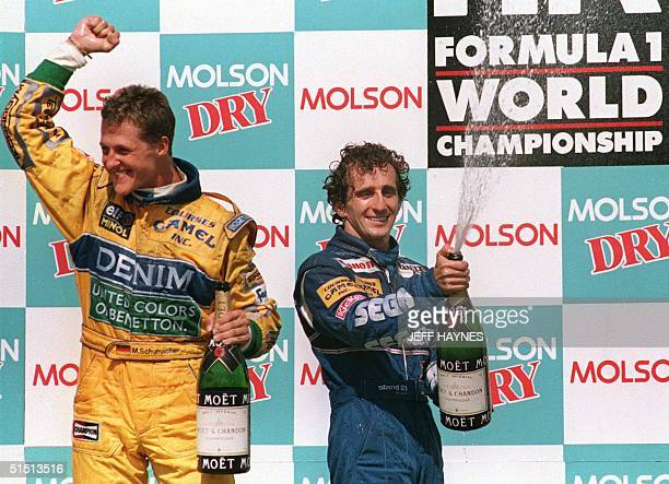 Photo taken 13 June 1993 shows French driver Alain Prost and German driver Michael Schumacher celebrating their first and second places respectively...