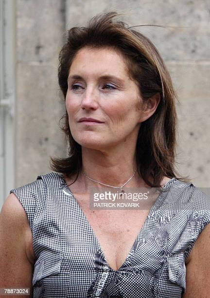 A photo taken 14 July 2007 in Paris shows former French first lady Cecilia Sarkozy attending the traditional garden party at the Elysee palace...