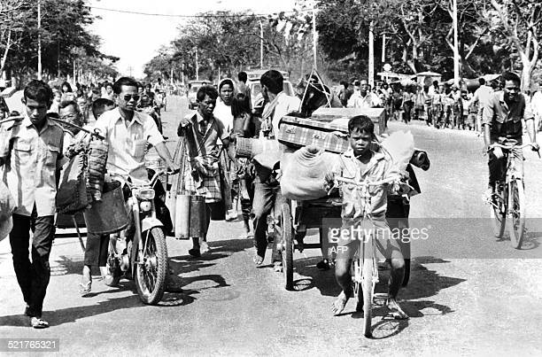 A photo taken 17 April 1975 in Phnom Penh of Cambodian refugees moving after the Khmer Rouge entered Phnom Penh and establish government of...