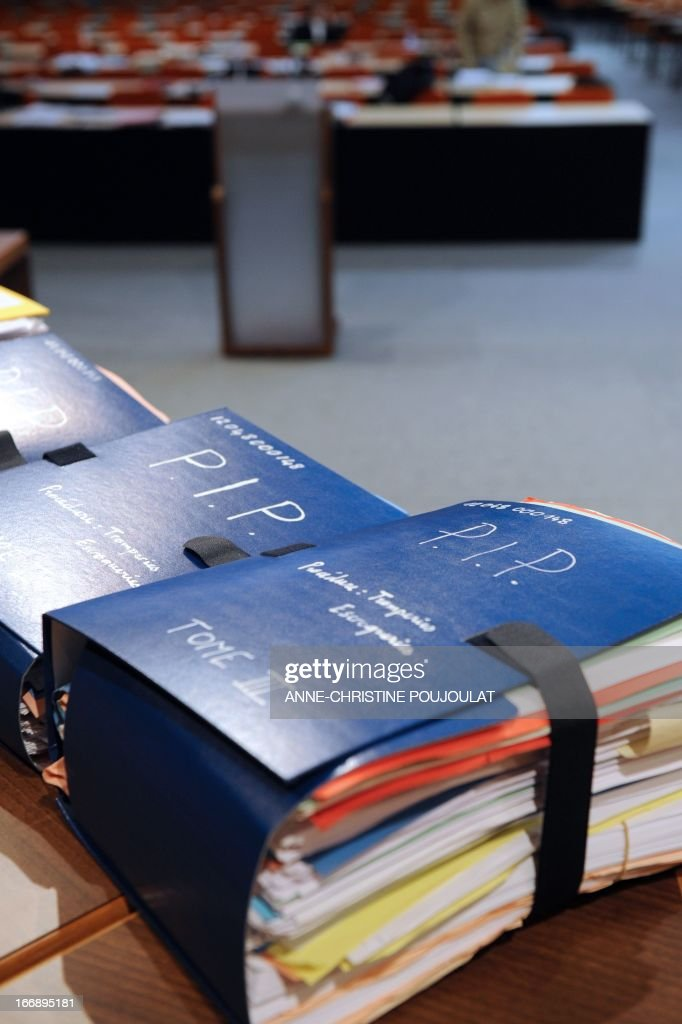 A photo taken April 18, 2013 shows files in the courthouse at the Parc Chanot in Marseille, southern France, before the trial of five managers of the French company Poly Implant Prothese (PIP), including its founder Jean-Claude Mas, who face fraud charges for allegedly selling faulty breast implants that sparked global health fears. PIP company was shut down on March 2010 and its product banned after it was revealed to have been using non-authorised silicone gel that caused abnormally high rupture rates of its implants.