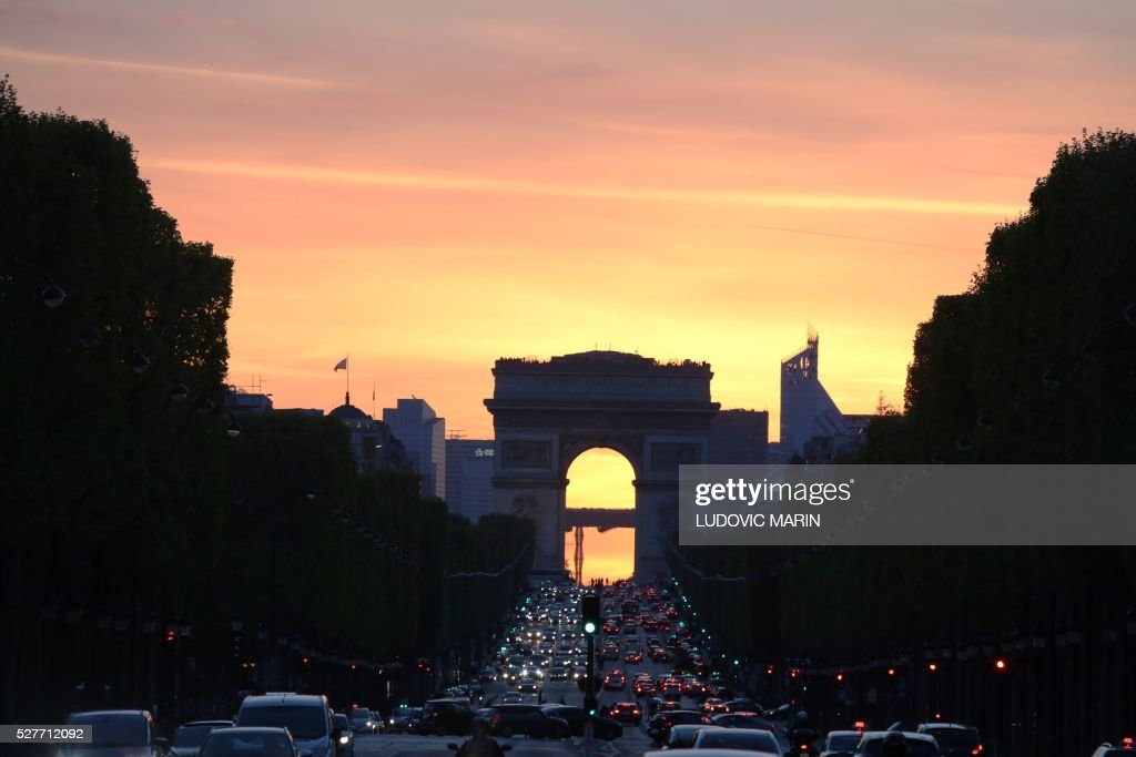 A photo taken at sunset on May 3, 2016 shows Champs Elysees Avenue in Paris. / AFP / LUDOVIC