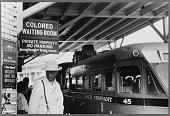 Photo taken at the bus station showing the Jim Crow signs of racial segregation Durham North Carolina May 1940