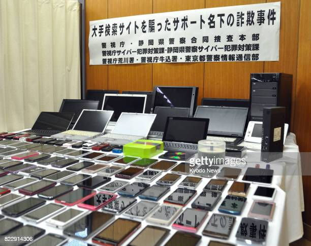 Photo taken at the Metropolitan Police Department's Arakawa station in Tokyo on July 26 shows smartphones and laptops seized for investigation Two...