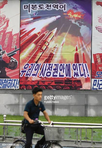 Photo taken Aug 17 in Pyongyang shows a signboard boasting of North Korea's missile capabilities ==Kyodo