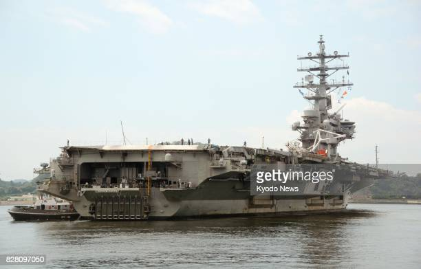 Photo taken Aug 9 shows the US aircraft carrier Ronald Reagan returning to the US Yokosuka Naval Base in Kanagawa Prefecture south of Tokyo The...