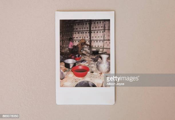 COX'S BAZAR BANGLADESH DECEMBER 03 A photo taken by 16 year old Farmina Begum of her aunt cooking breakfast in a refugee camp is seen December 3 2017...